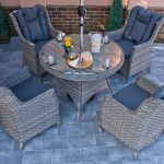 Round Garden Dining Table and 4 Wing back Armchairs