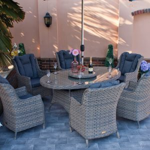 Elliptical Garden Dining Table and 6 Wing back Armchairs