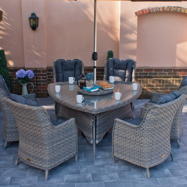 Triangular Garden Dining Table and 6 Wing back Armchairs